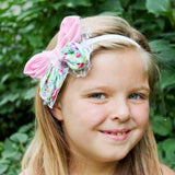 Child in butterfly bow hair band