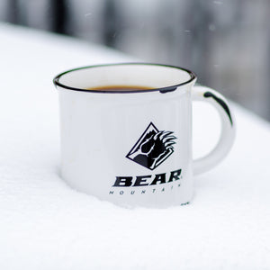 bear mountain branded coffee mug, sitting in the snow