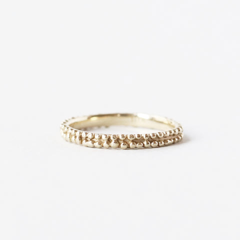 A perfectly imperfect solid 10k yellow gold ring that speaks to one's desire to embrace modernity and antiquity. Two delicate rows of tiny granulation make this band look as though it was unearthed from ancient Rome.