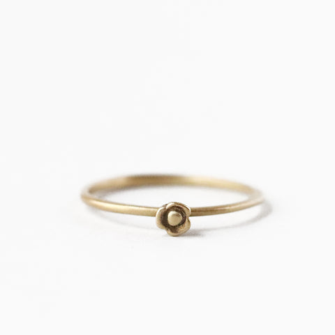 The tiny three petaled blossom sometimes known as Purple Queen, is perfect rendered into this solid 10k yellow gold ring. Wear it on its own or as part of a stack.