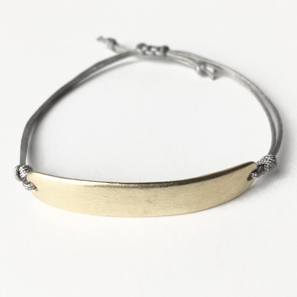 When you're looking for a more substantial friendship bracelet, this is the one for you. Perfect left plain, or try it with an engraved name or a special date. Bracelet is a solid heavy 10K yellow gold bar finished with an indestructible AND adjustable  cord closure.