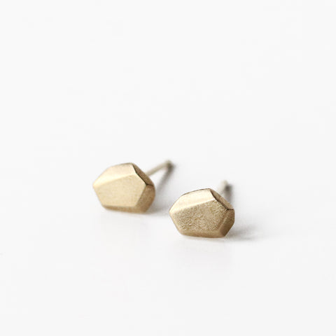 These irregular faceted 10k solid yellow gold nugget posts are ideal for everyday. They are modern, but not hard-edged, and look stunning with pretty much everything.