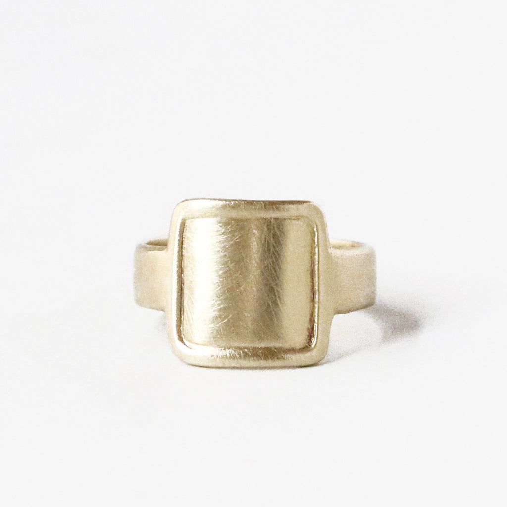 A riff on the classic square signet ring and a cigar band. Solid 10K yellow gold ring.