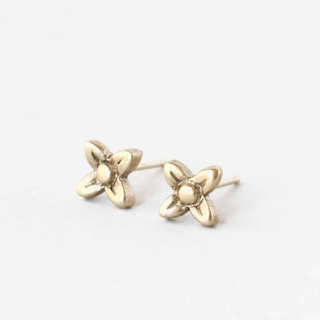 10k solid yellow gold sweet woodruff flower posts.