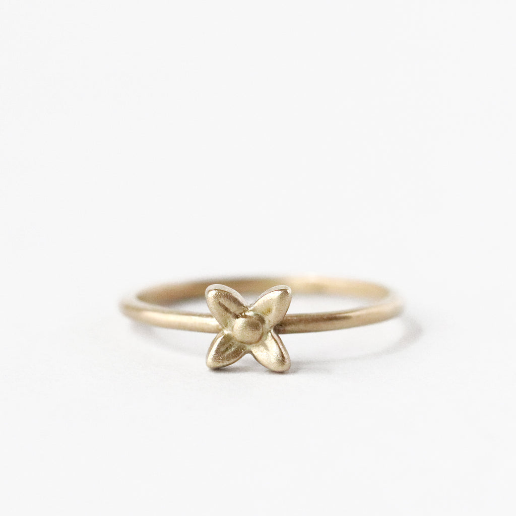 The four-petaled sweet woodruff flower is known, and prized, for its delicate scent. This solid 10k yellow gold ring is equal in charm to the fragrance of the real thing. Stack it with some other flower rings, or a delicate plain band or two.