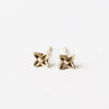 These tiny solid 10k yellow gold sweet woodruff flower post earrings are both delicate and edgy. Small, perhaps, but definitely noticeable. Mix and match with the other posts in this collection.