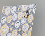 magnet-board-16inx16in-no-frame-yellow-and-gray-bursts-fabric