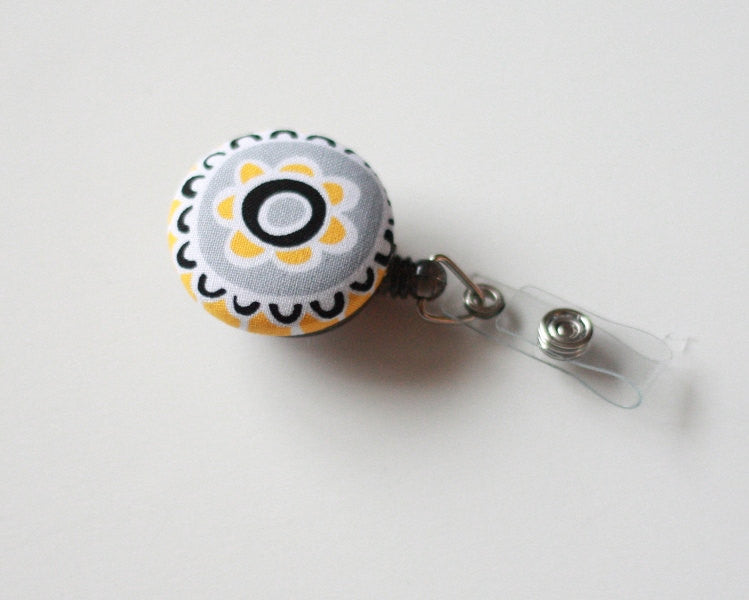badge reel id holder yellow gray flower