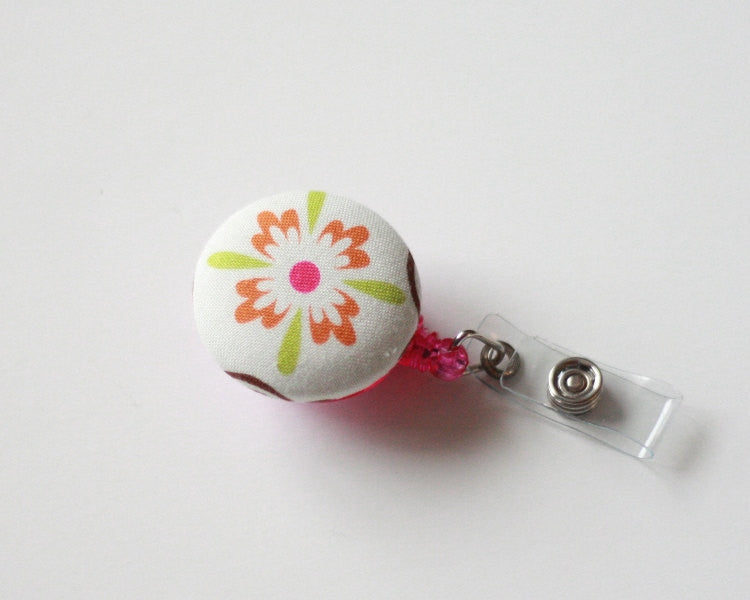 badge reel id holder orange and green flower