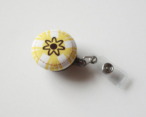 badge reel id holder yellow burst