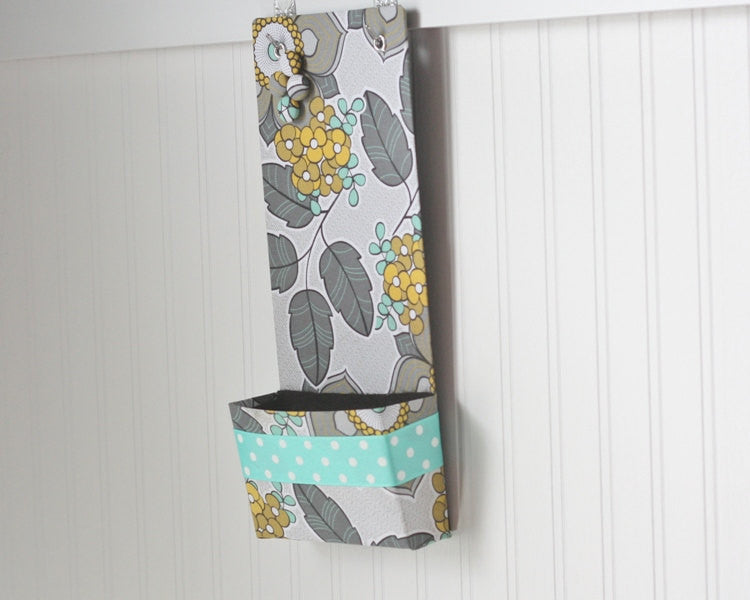 narrow-message-center-magnet-board-with-closed-pocket-gray-turquoise-and-mustard-floral-with-polka-dot-ribbon-detail