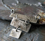 Little silver strip pendant necklace shown on gray stone