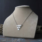 Sterling silver inverted pyramid necklace shown on tan bust