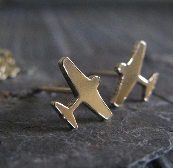 Tiny airplane travel stud earrings