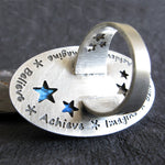 Back of ring with blue stars and Imagine Believe Achieve Engraved
