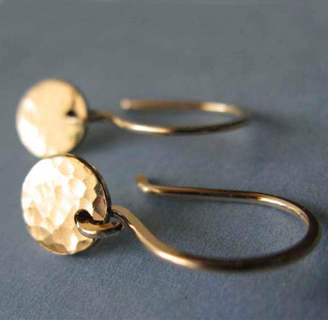 Little gold earrings with hammered disc gray background