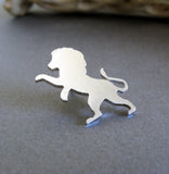 Silver standing lion tie tack on gray background