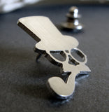 Side view of steampunk top hat man tie tack pin on gray