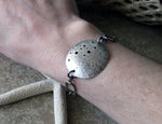 Sterling Silver handcrafted disc bracelet. Unique statement jewelry. Sam
