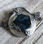 Dark blue Moss Agate pendant on wood grain