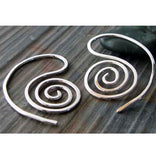 silver spiral earrings on gray stone