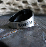 Sterling Silver Ring with Engraved Pet Name on Stone Gray Background with Branch