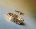 Set of 3 thin gold stacking rings on gradient