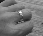 Three thin rings shown on hand in black and white