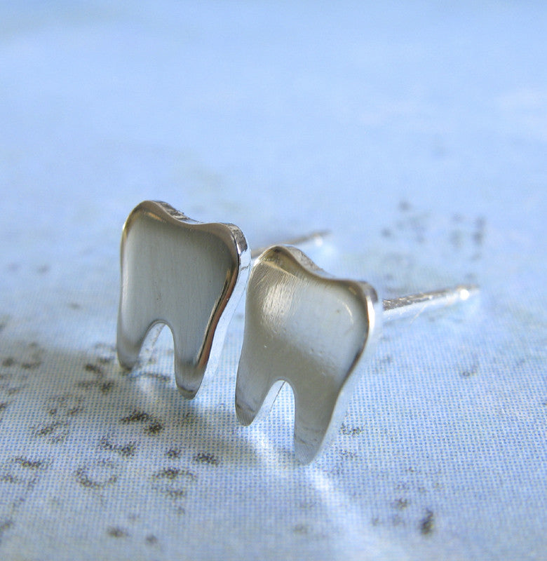 Tooth earrings hand made from sterling silver or 14k gold.