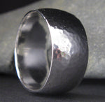 Sterling silver wide hammered ring band close up