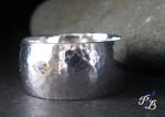 hammered silver wide band ring close up