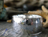 Wide sterling silver hammered ring band
