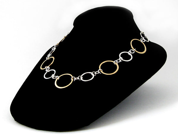 Mixed metal silver and gold ring statement necklace