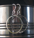 hanging silver hoop earrings on silver tin can