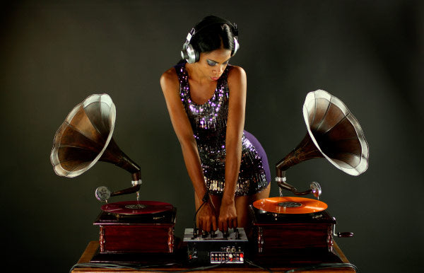 Woman in headphones DJ with gramophones for the hip hop shop