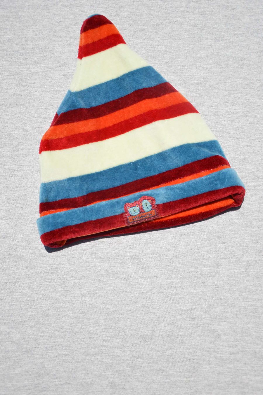 OshKosh - nearly new - cream, blue & reds striped beanie, size 3-6m
