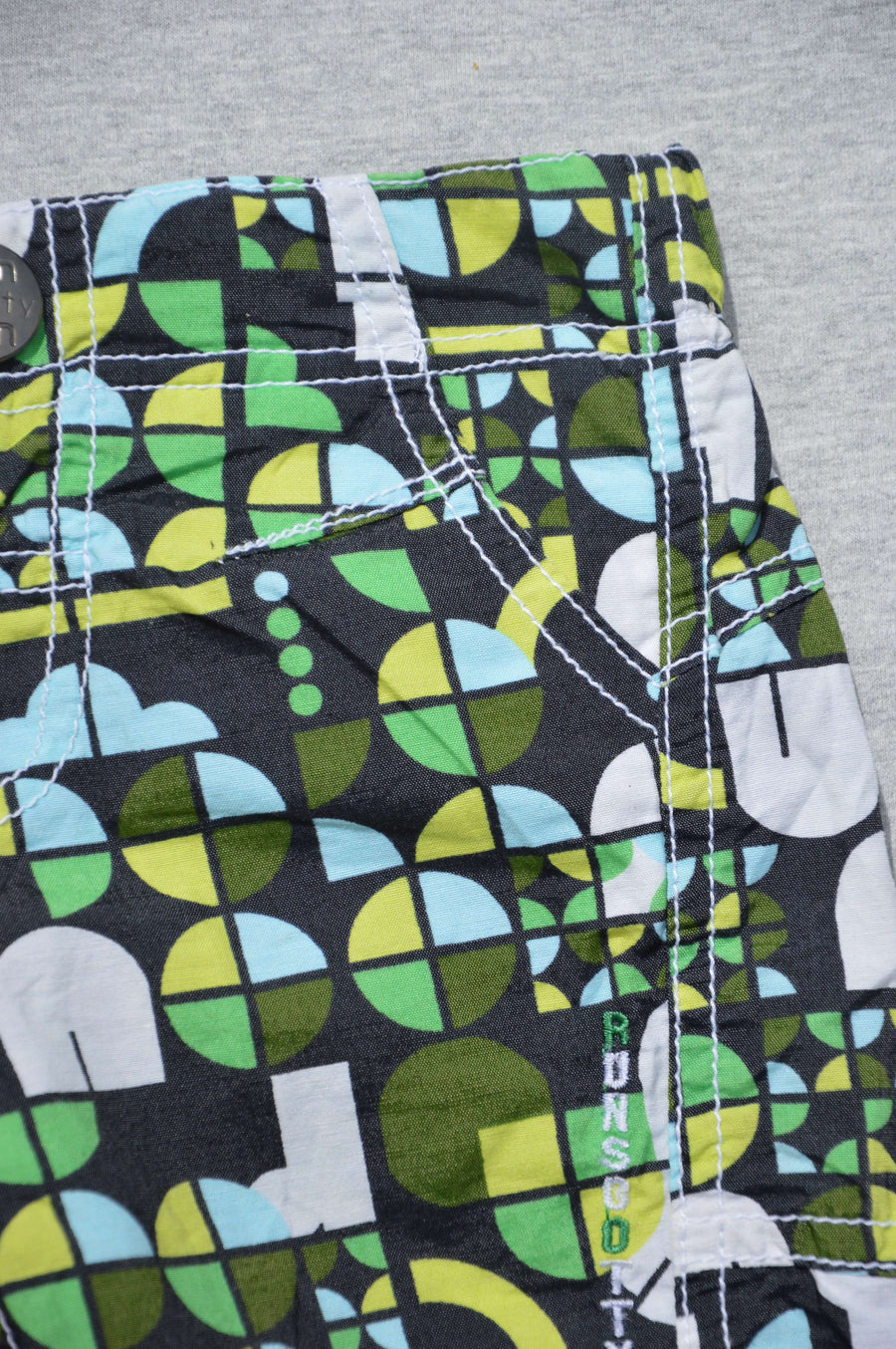 Run Scotty Run - nearly new - black & green patterned shorts, size 3-6m