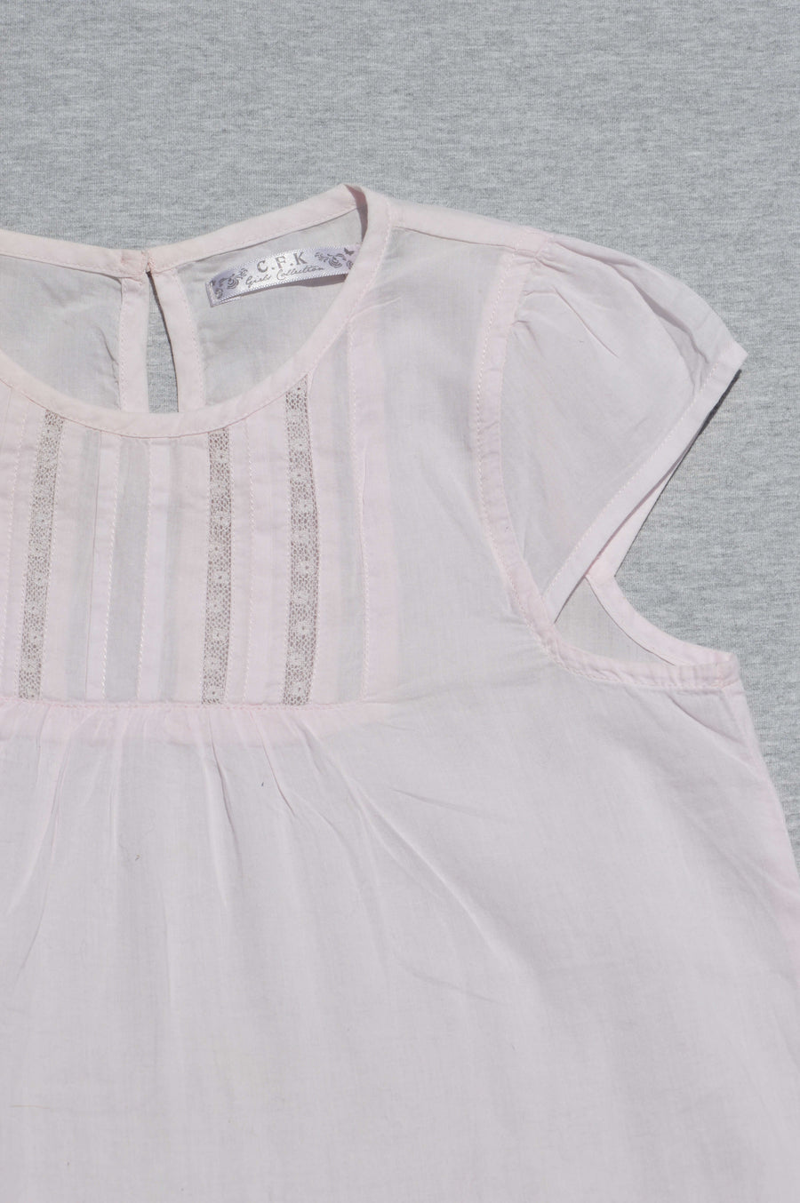 C.F.K pale pink floaty top, size 10