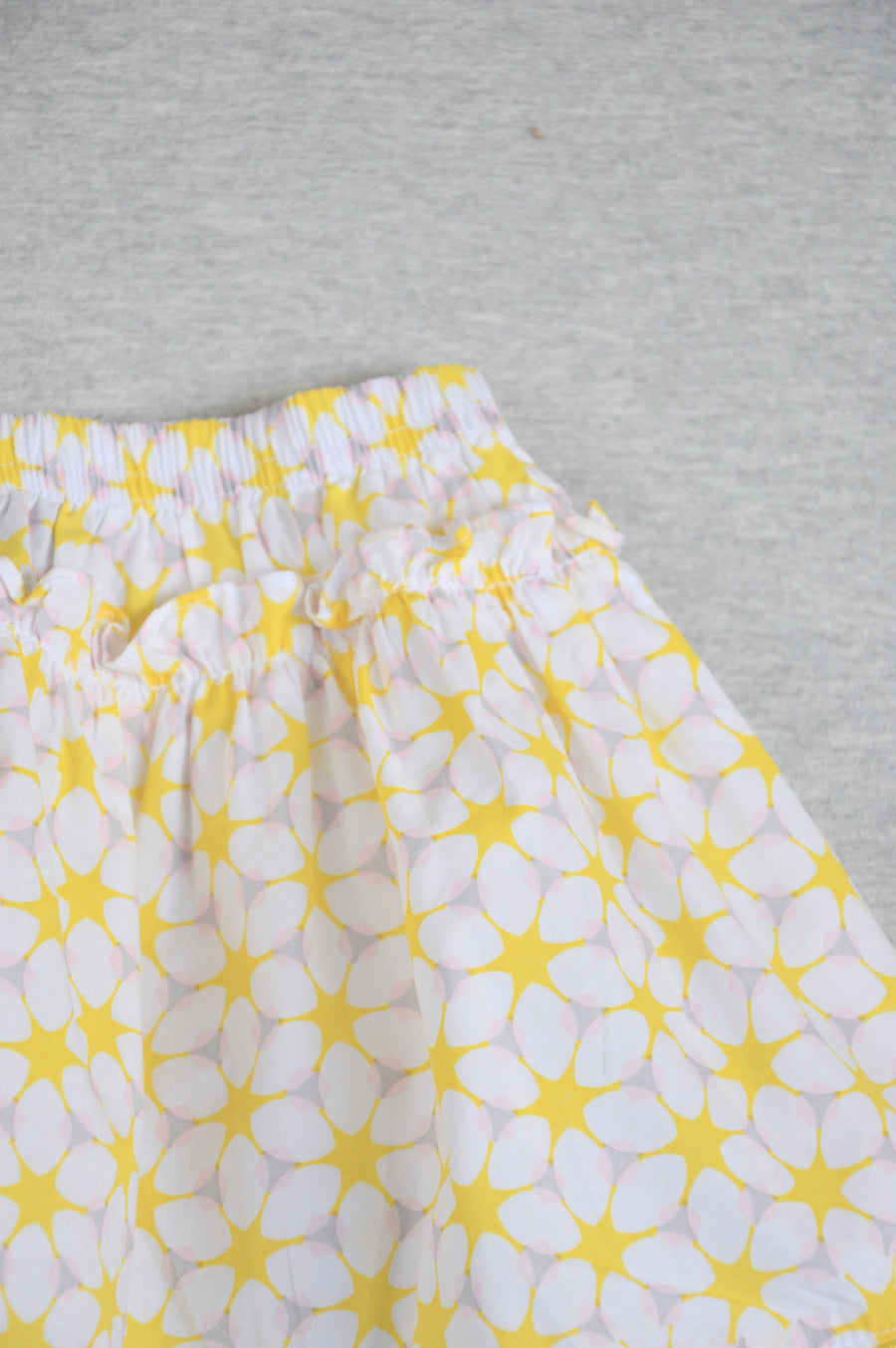 Papoose - nearly new - white & yellow patterned skirt, size 6-12