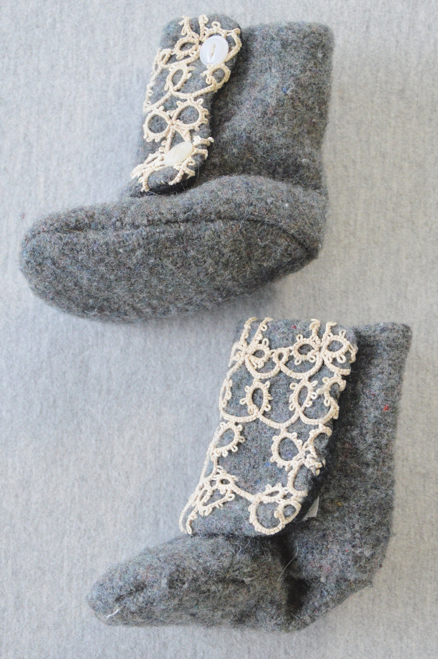 Dark grey woollen-feel booties with cream lace, size NB