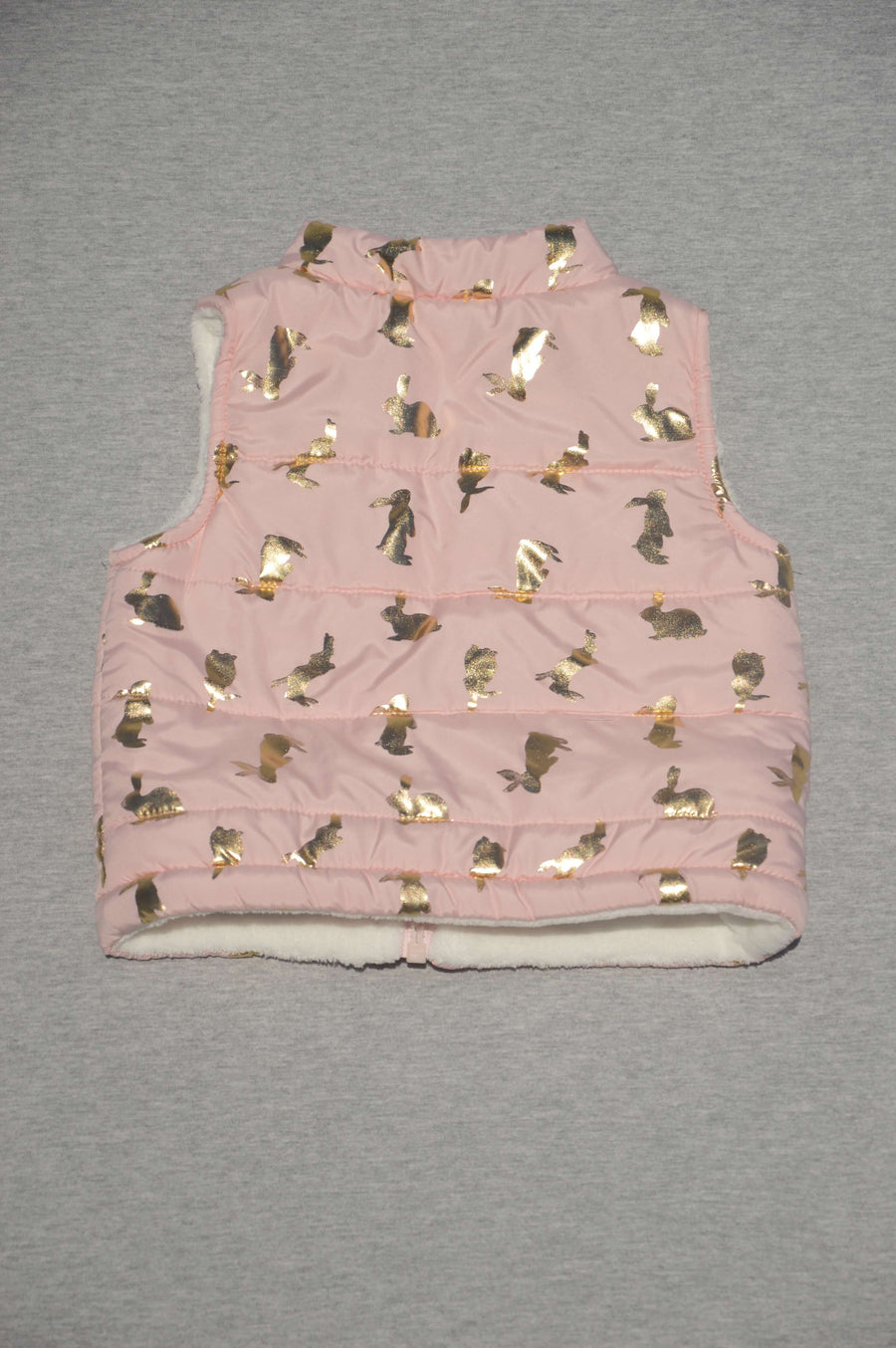 Teeny Weeny - nearly new - vest with printed gold rabbit pattern, size 3-6m