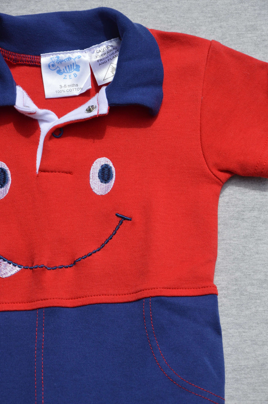 Zeb - nearly new - funky red & blue onesie, size 3-6m