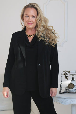 Black pants, black drape neck shell, black blazer