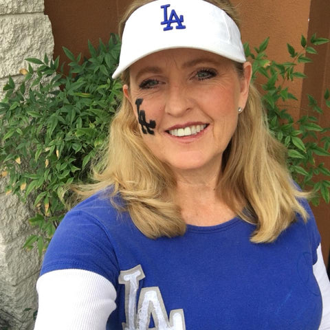 Danielle in a Dodgers baseball cap