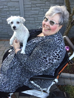 Diane in black & white animal print Vikki Vi with her dog Inspector Clouseau