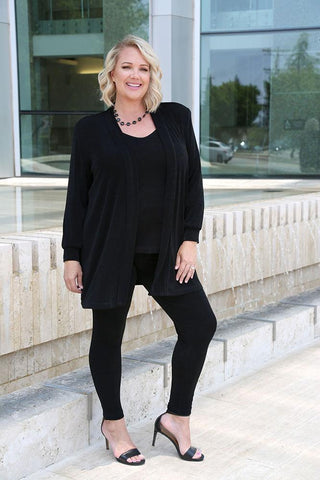Danielle in black plus size leggings