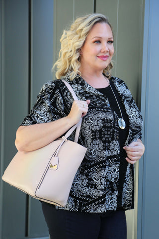 Danielle in black top with light pink structured tote purse
