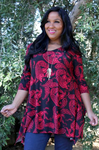Allegra in a red print tunic