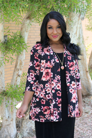 Allegra in a cherry blossom print swing cardigan