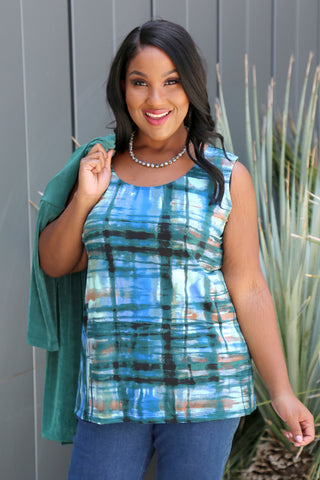 Allegra in a blue print top